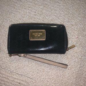 Micheal Kors patent leather logo wristlet Wallet